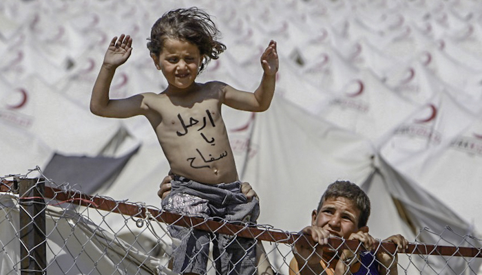 Thousands of Syrian refugees have poured over the border into Turkey and Lebanon to escape the terror. A young refugee settles into a new life at a camp in Boynuyogun, Turkey. Foto taken by Syria Freedom, via Flickr.