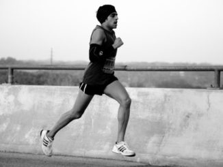 Austin Marathon runner, door Charlie Llewellin, via Flickr.