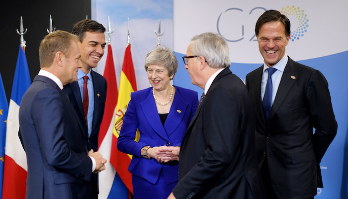Photo of (from left to right) Donald Tusk, Pedro Sánchez, Theresa May, Jean-Claude Juncker and Mark Rutte at the G20 summit in Argentina. Photo by: Number 10, via Flickr.com
